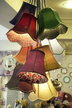 If I had a high ceiling i;d love these vintage lampshades clustered like this on my stairwell light.