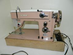 Vintage PINK Nelco Sewing Machine.  Mom's sewing machine; however hers was part of a desk.  Instead of a foot pedal, you pushed your knee against a lever.