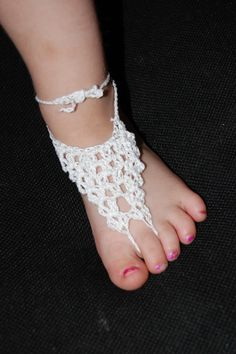 My daughter would love these!      Lace Toddler Barefoot Sandals by LoopandChain on Etsy, $10.00