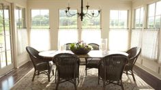Casual Dining Room | Sheer cafe curtains, hung just above the bottom sash, give the dining room softness and privacy while still allowing a view of the outside and inviting lots of sunlight to stream in through the upper panes. | #SLIdeaHouse | SouthernLiving.com