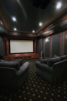 Luxury home theater Imagine the black rug is our burgandy rug. Use color coordinated fabrics to make wall treatments that break up the long wall