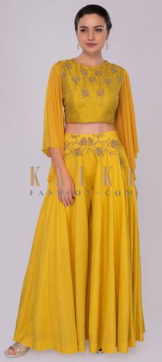 Buy Online from the link below. We ship worldwide (Free Shipping over US$100)  Click Anywhere to Tag Chrome yellow palazzo with butter yellow embroidered crop top only on Kalki Chrome yellow cotton flared palazzo.Paired with a butter scotch yellow raw silk crop top with self thread floral embroidered neckline along with cut dana and moti highlight.Styled with an asymmetric flared lycra sleeves. Palazzo Suit, Crop Tops Online, Indian Wear, Indian Style, Party Wear, Indian Fashion, Two Piece Skirt Set, Bridesmaid Dresses