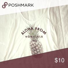 """""""Aloha From Honolulu"""" Pineapple Tank White tank top in perfect condition. Somewhat cropped. """"Aloha From Honolulu"""" and a pineapple on it. *Not Brandy (Also selling the shorts modeled on my page) Brandy Melville Tops Tank Tops"""