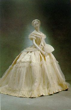 Charles Frederick Worth  1865 satin ballgown trimmed with tulle, swansdown, crystals  and pearls.