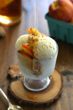 bourbon honey ice cream with brown butter crumble and fresh peaches