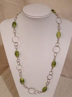 Necklace with silver rings and green glass beads.