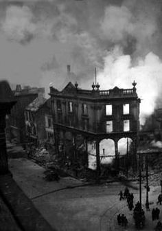 WORLD WAR II: BELFAST AIR RAIDS. HARLAND & WOLFF. 4/5 May 1941. The International Bar (corner of Donegall Street and York Street) still ablaze. AR 107.