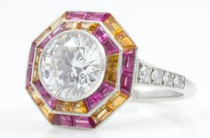 This octagonal ring from Tiffany & Co. is set with a 1.84-carat round diamond, 16 pink sapphire baguettes, 16 baguette spessartite garnet baguettes and eight round diamonds ($83,200).