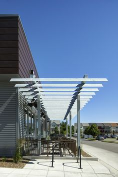 Wonderful awning structure infront of the store. makes the intense west side…