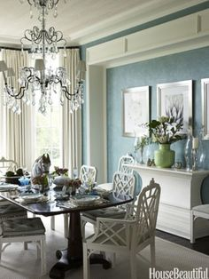 Love the set up of this dining area, the furniture and frames on wall, and color scheme.