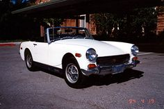 1972 MG midget - My DREAM car....can just picture myself driving it with a head scarf and a picnic basket at Lake Eacham