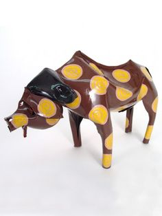 Large Tin Buffalo  $36.00. The cape, or African, buffalo may reach 7 ft in length, weigh more than 1,500 lb, and reach a height of 5 ft at the shoulder. Cape buffalo gather in herds of up to a thousand animals. They are aggressive and powerfully built, and can easily fend off the attack of a lion.