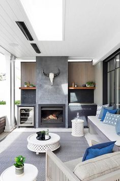 In the outdoor living room and kitchen, the material palette here includes timber shelves made from recycled rail sleepers, teak wall cladding, marble splashbacks and a fireplace in burnished black concrete Outdoor Rooms, Outdoor Living, Outdoor Kitchens, Outdoor Patios, Indoor Outdoor Kitchen, Built In Braai, Timber Shelves, Outdoor Kitchen Design, Patio Design