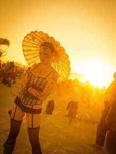 I caught this #tattooed girl with an umbrella at the tail end of another guy's photo shoot. Isn't #Burning_Man awesome? from #treyratcliff at http://www.StuckInCustoms.com - all images Creative Commons Noncommercial