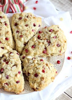 Substitute GF flour. Easy, flaky, buttery, and tender Pomegranate White Chocolate Almond Scones with white chocolate chips, slivered almonds, and pomegranate seeds.