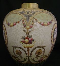 Vase has a musical and fruit motifs. The vase has an embossed lace-like surface with a matt finish. The mark is pre-1903 in very good condition. The