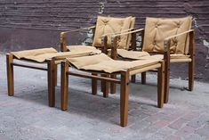 Adventurous Mid Century Modern Leather Campaign Safari Chairs and Ottomans (U.S.A. 1960s)
