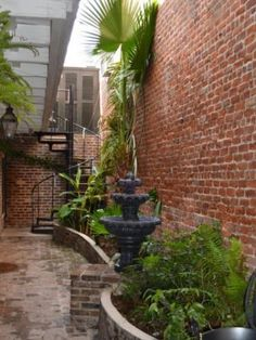 Burgundy Street New Orleans Courtyard - Modern Visit New Orleans, New Orleans Homes, Brick Courtyard, Courtyard Ideas, Gothic Garden, New Orleans French Quarter, Patio Flooring, Brick Patios, Outdoor Living