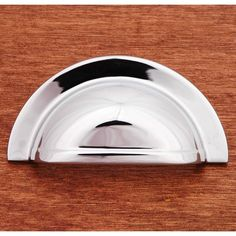 This polished chrome finish cabinet/drawer cup pull with smooth half circle design from RK International is perfect for use on cabinet doors and drawers capable of accepting a mounted pull.