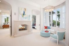 Soft tones give this home a chic and restful atmosphere while Art Deco elements add glamour. (=)