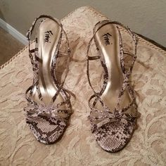 PYTHON PRINT STRAPPY HEELS These 3-inch heels are Sexy and Comfortable! Worn twice! ..they are in great condition! Fioni  Shoes Heels