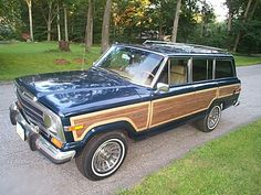 old Jeep Grand Wagoneers with wood paneling