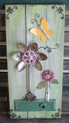 This lovely art work is by Imperfetions (Etsy). It's made from reclaimed tongue and groove barn wood, silverware, spigot handles and an old door plate!  https://www.etsy.com/shop/Imperfetions