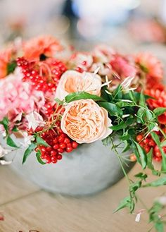 Bouquet Inspiration: Red, peach, and pink flowers. Red and White Anniversary Party from Alison Events by Lisa Lefkowitz on Snippet and Ink — Loverly Weddings
