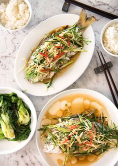A Chinese Steamed Fish topped with Ginger and Shallots and seasonings, with hot oil poured over it to create a dramatic sizzle and an amazing sauce. So simple, yet so utterly delicious. Steam OR bake the fish! Fish Dishes, Seafood Dishes, Seafood Recipes, Cooking Recipes, Healthy Recipes, Cooking Fish, Chinese Fish Recipe, Chinese Steamed Fish, Chinese Food