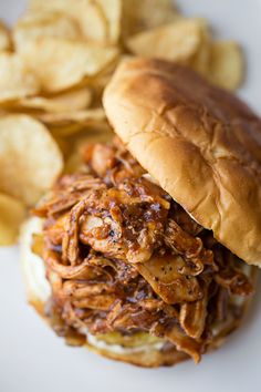 """A great alternative to the sausage sandwich! Smoky Hawaiian-BBQ """"Pulled"""" Chicken Sandwiches on Toasted Hawaiian Buns, with Grilled Pineapple and Maui Onions ~ Delish! Pulled Chicken Sandwiches, Chicken Sandwich Recipes, Pork Recipes, Slow Cooker Recipes, Crockpot Recipes, Cooking Recipes, Pulled Chicken Recipes, Chicken Pulled Bbq, Shredded Bbq Chicken"""