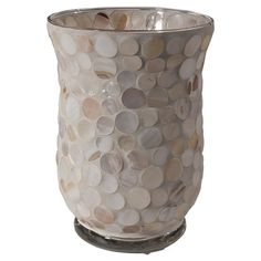 Cast a flickering glow over your bedside or dining table with this glass candleholder, showcasing a soft-hued mosaic motif.  Product...