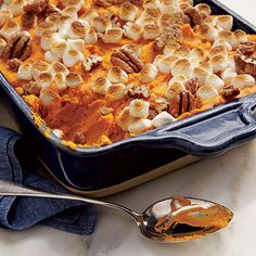 Sweet Potato-Carrot Casserole | Sugared pecans and mini marshmallows add a sweet note to this updated Thanksgiving classic.