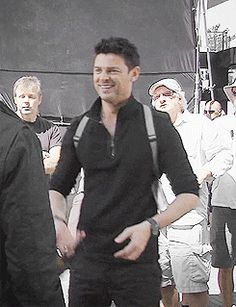 Tumblr - GIF of Karl Urban BTS of Almost Human. He's smiling *and* wearing the shoulder holster - how great is that?