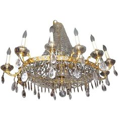 An oval circa 1920 French gilt bronze and rock crystal neoclassic style chandelier. Measures: Height: 39 in.Depth: 30 in.Width/length: 38 in. French Chandelier, Chandelier For Sale, Italian Chandelier, Bronze Chandelier, Vintage Chandelier, Chandelier Pendant Lights, Crystal Pendant, Quartz Crystal, Crystal Beads