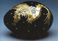 """Dragon Egg""  Theo Fabergé's creation in tribute to his grandfather Carl Fabergé who was one of the first to interpret oriental influence onto jewelery. Thus the Egg is made from jet black crystal and hand painted with raised 23 carat gold. A design inspired by the delicate work of ancient oriental craftsmen. Finally, the fiery eye of the dragon is a glittering faceted ruby."