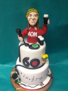 60th Birthday Cake for Man united, Guiness drinking DJ :) www.facebook.com/jmcrumbs 60th Birthday Cake For Men, Self Thought, Novelty Cakes, Man United, Guinness, Liverpool, Drinking, Cake Decorating, Wedding Cakes