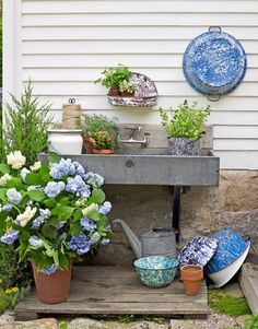 Outdoor potting bench made from old soapstone sink. Love.