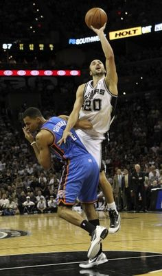 Was on vacation during Game 1 coverage: Spurs guard Manu Ginobili contorts himself to take a shot around Thunder guard Thabo Sefolosha in the second half. Ginobili finished with 26 points, making 3 of 5 from 3-point range.  Kin Man Hui / San Antonio Express-News
