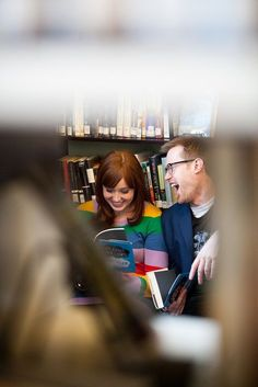 Eliza & Josh' self-described nerdy meets hipster engagement session in a library! Images by Stephen Deleon.