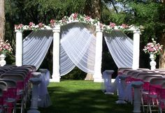 Ambiance~  A beautifully draped and decorated wedding arch for Spring or Summer Ceremonies~  (Photo Credit: shibawi.com)  (410) 819-0046  www.maryannjudy.com