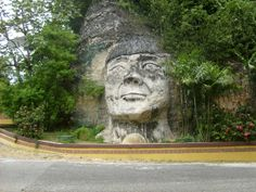 Taino Indian Face Sculpture in Isabela - To see the sculpture, simply drive towards Aguadilla from Arecibo on road 2. Take a right towards road 113. The sculpture is located on the north part of the intersection. There is no place to park, so you must observe the landmark from your car.