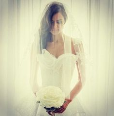 This bride looks lovely in a Lace fingertip veil