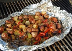 GRILLED SAUSAGE AND PEPPERS === I was trying to come up with a super easy quick meal the other night and threw this together.  It worked out great and was a 'one' tinfoil meal!  1 onion, sliced 1 green pepper, sliced 1 red pepper, sliced 3-6 red potatoes, medium cubed 3-6 Italian/Polish sausage, cut into chunks olive oil/spray seasoning to taste =====