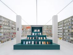 Inside, the Duoyun Bookstore is split across two levels and five different colour-coded zones. Lecture Theatre, Chief Architect, Internal Courtyard, White Pebbles, Blue Colour Palette, Perforated Metal, House On The Rock, Exhibition Space, Glass House