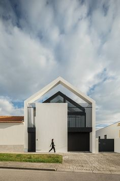 Completed in 2018 in Aveiro, Portugal. Images by ITS – Ivo Tavares Studio. At the end of Maria Fradinho designs and builds her own office and home, on a 940 m 2 lot, located on the outskirts of Ílhavo, Portugal. Arch House, House Roof, Industrial Architecture, Architecture Design, Facade Design, Lofts, National Landmarks, Watercolor Architecture, Rest House