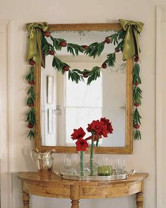 Bay Leaf and Pomegranate Garland Christmas Decor Ideas | Martha Stewart Living — Drape this delicate garland over your mantel, banister, or mirror this holiday season.