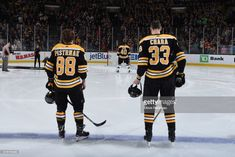 David Pastrnak #88, Tuukka Rask #40 and Zdeno Chara #33 of the Boston Bruins stand for the national anthem before the game against the Buffalo Sabres at the TD Garden on February 10, 2018 in Boston, Massachusetts.