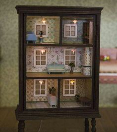 Dresser w/ missing drawers into doll house.