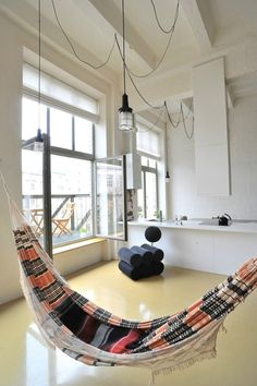 Factory loft with an integrated hammock by Inblum Architects//