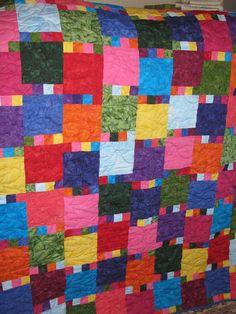 Lap Quilt  Bold and Bright Batik by QuiltsintheCity on Etsy, $125.00  Use jewel tone fabrics.